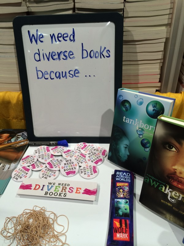 Lee & Low Books with #WeNeedDiverseBooks bling